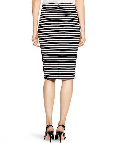 Treat a black and white striped skirt like it's a solid black or white, and go with it. Try a bold color or a neutral or consider a graphic tee! How to Wear a Black & White Striped Skirt. This black and white pencil skirt from from Kohl's is perfect for wearing with a dressy white blouse and pumps.